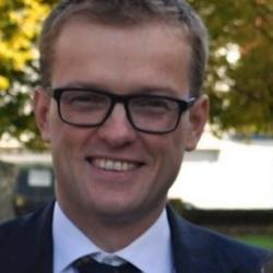 Dr Adam J. Brown